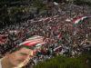 Bashar Assad supporters mass in Lattakia, Syria, 2010.