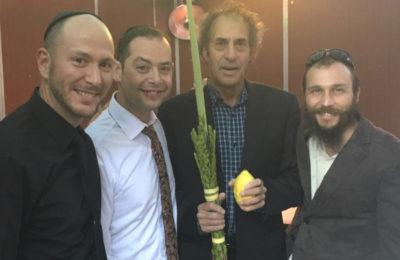 In the Vituks' sukkah, l-r: Ben Wolsh, Tim Dover, Chaim Maultasch, Rabbi Boaz Vituk