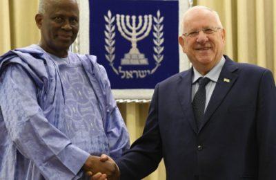 Guinea's ambassador to France, Amara Camara, meets Israeli President Reuven Rivlin, right.