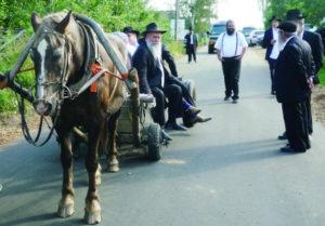 Rabbi Jehoshua Raskin shares a ride with other visitors to Lyubavichi, Russia, Aug. 26.